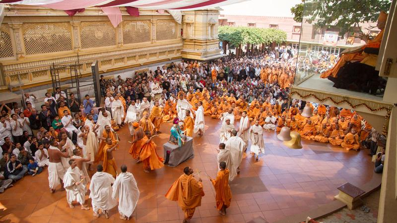 Sadhus and parshads rejoice before Bhagwan Swaminarayan (Utsav murti)