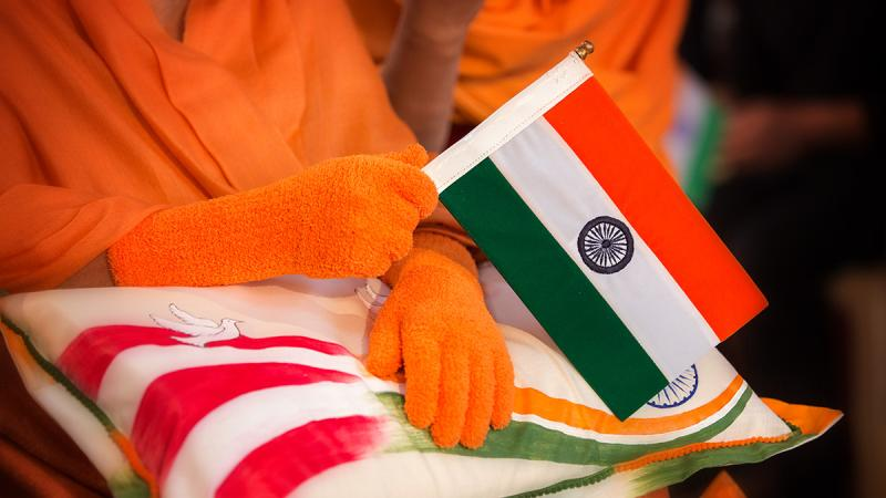 Swamishri waves the Indian tricolor on the Republic Day of India