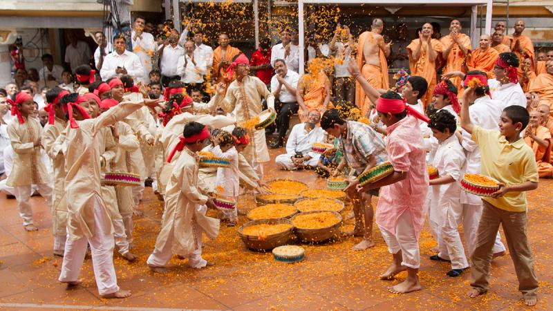Kids join the Pushpadolotsav celebrations with flower petals