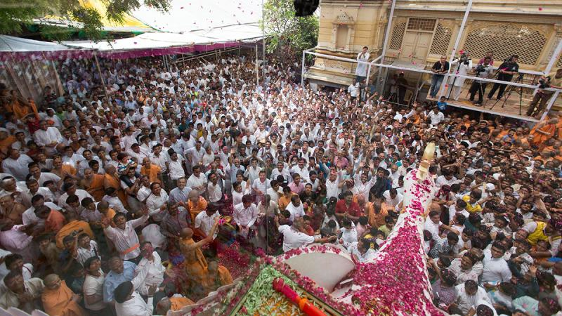 Sadhus and devotees rejoice during the Pushpadolotsav festival