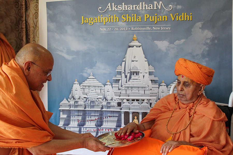 Swamishri sanctifies yantras to be placed beneath the Jagtipith stone at Akshardham, Robbinsville, NJ, USA