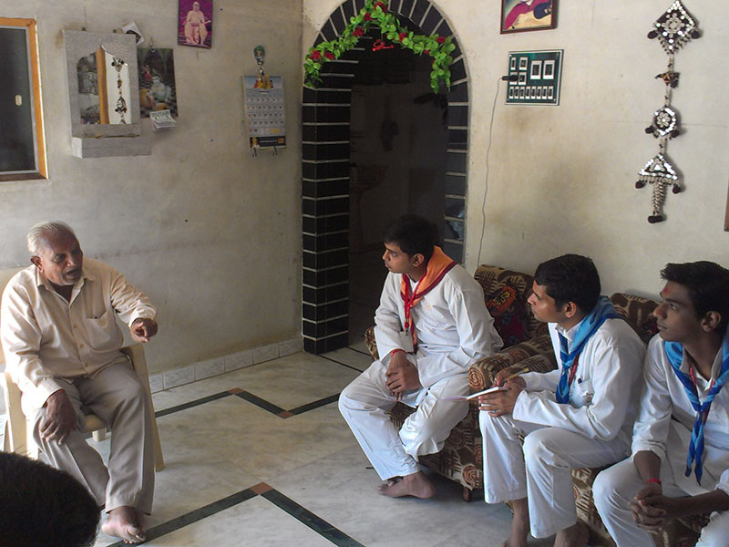 Meeting devotees and villagers individually, at their homes and workplaces