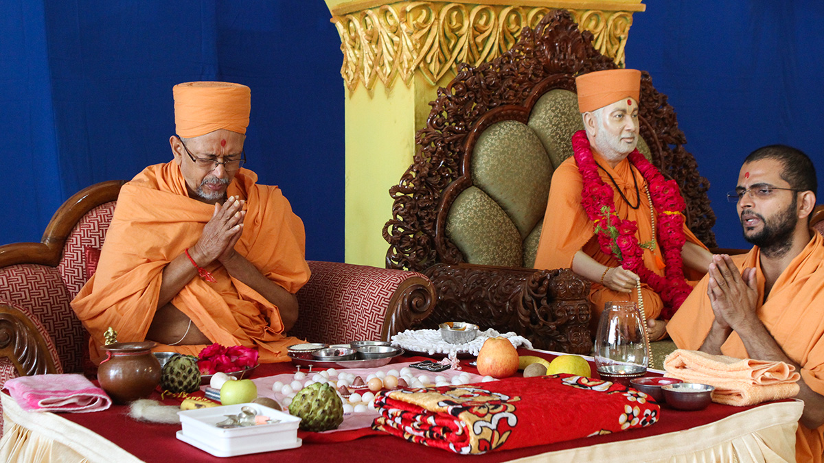 Pujya Tyagvallabh Swami performs bhagwati diksha mahapuja ceremony for the initiation of two youths as sadhus