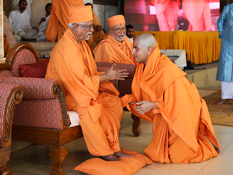 Senior sadhus bless the newly initiated sadhus during the diksha ceremony