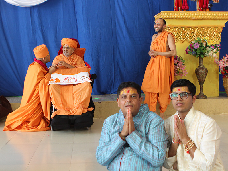 The father and brother of the newly initiated sadhu before his diksha culminates with the diksha mantra