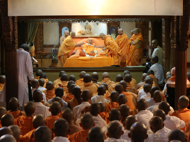HH Pramukh Swami Maharaj is honored with a garland