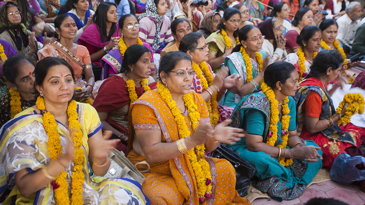 Mothers of the newly initiated sadhus honored with garlands