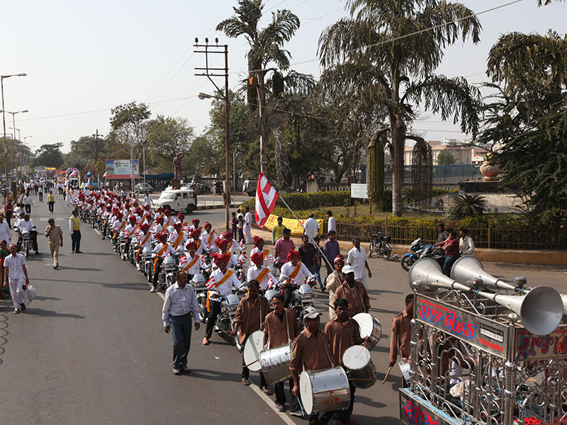 A colorful and joyous musical procession of the murtis through the streets of Jamnagar begins