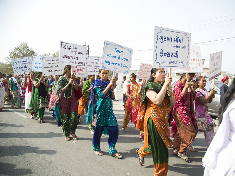 Women devotees participate in the procession with anti-addiction messages
