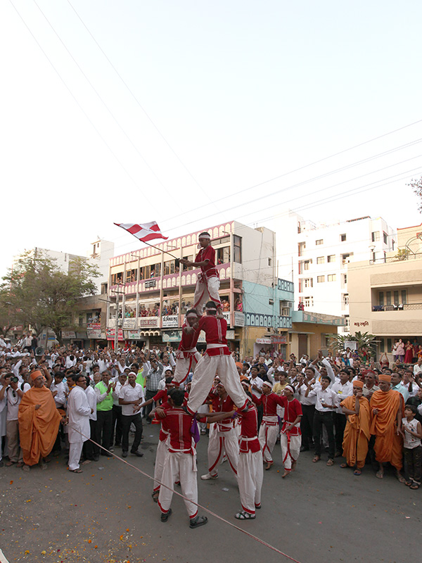 Tribals from the region participate in the procession