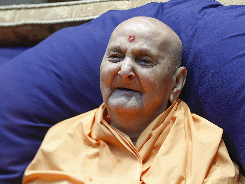Swamishri in a divine, jovial mood at night