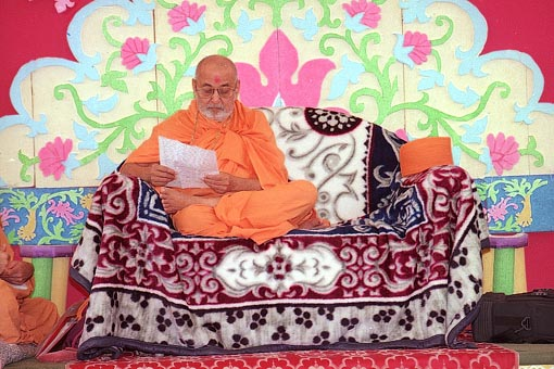 Engaged in reading a devotee's letter