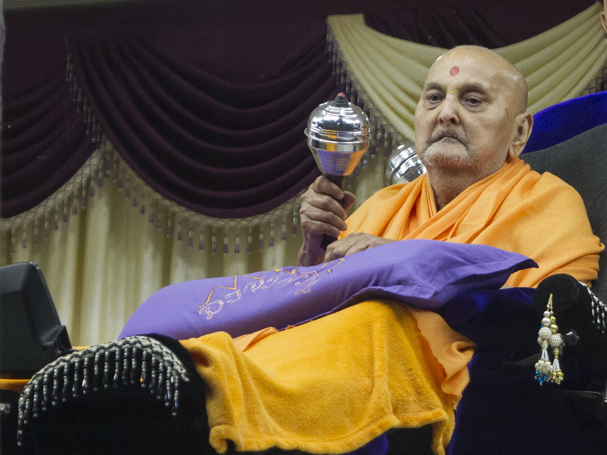 Swami plays a musical instrument