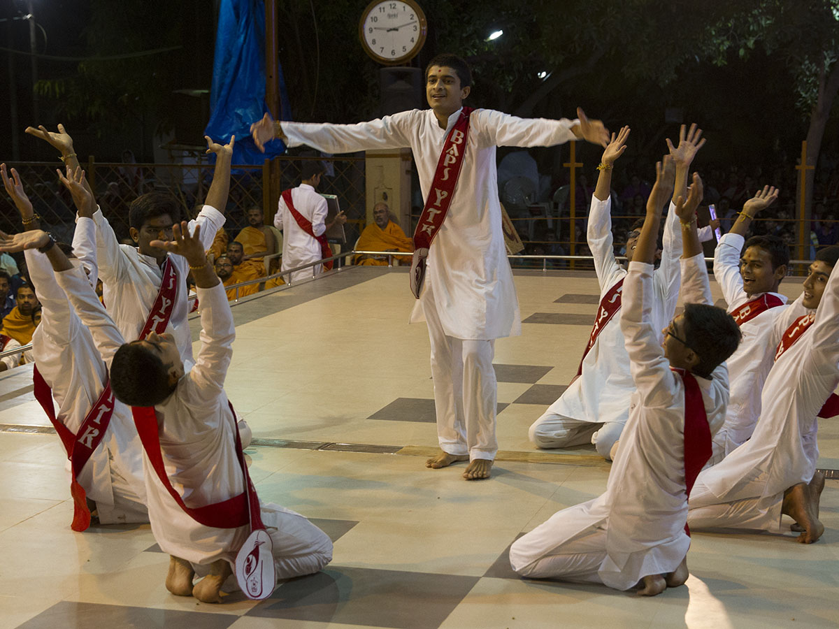 Yuva Talim Kendra youths perform a cultural dance before Swamishri