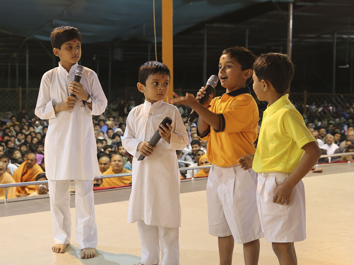 Children make a presentation before Swamishri