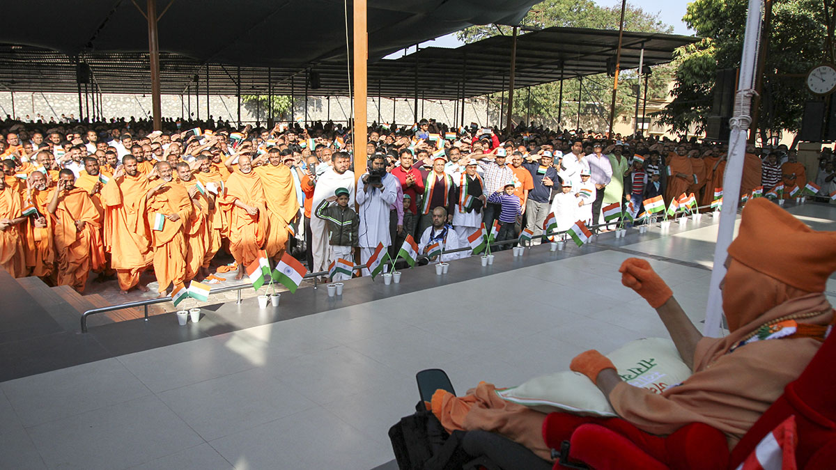 Sadhus and devotees salute the Indian tricolor flag