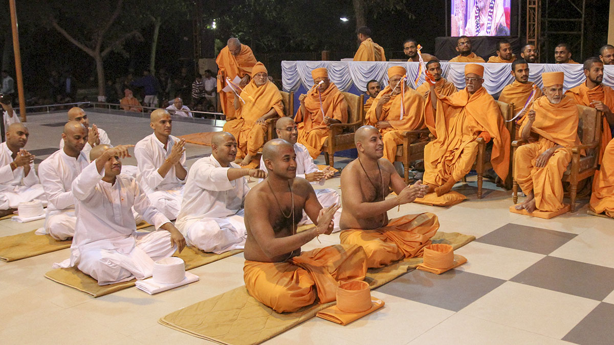 Newly initiated sadhus and parshads participate in diksha ceremony