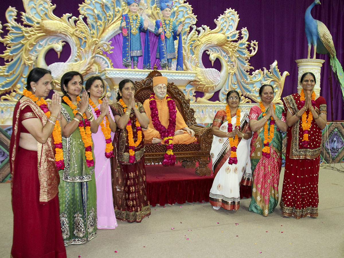 Mothers of sadhaks (soon to be initiated as parshads) are honored with garlands