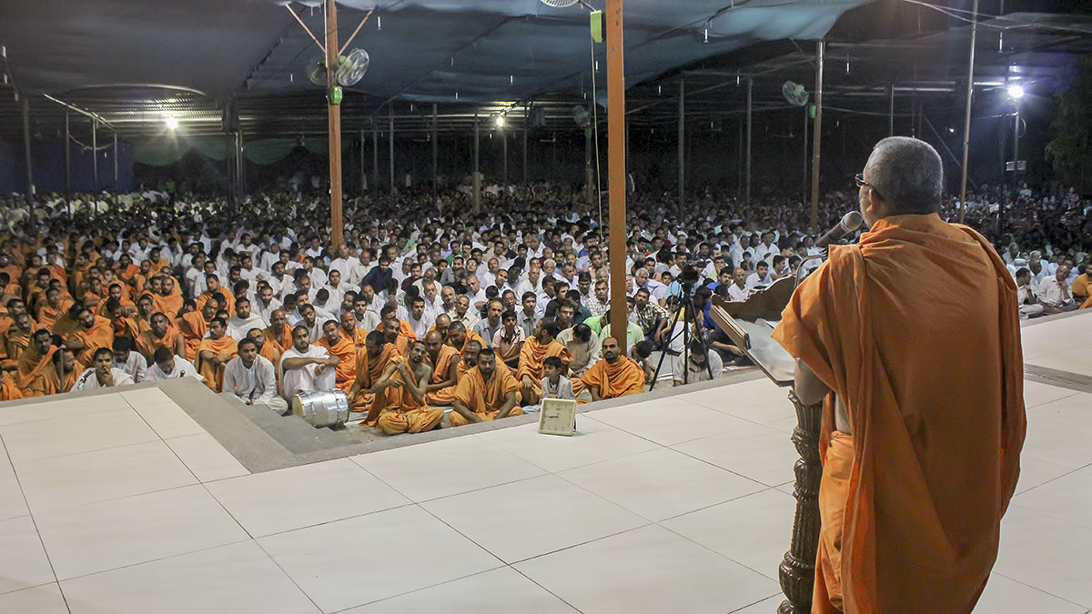 Sadhus and devotees during Shri Swaminarayan Jayanti celebration assembly in the evening